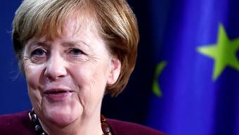 Bundeskanzlerin Angela Merkel (CDU) gibt nach einem virtuellen G20-Gipfeltreffen eine gemeinsame Pressekonferenz mit Bundesfinanzminister Scholz im Bundeskanzleramt. Foto: Hannibal Hanschke/Reuters-Pool/dpa