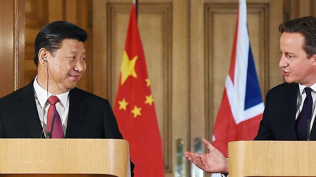 Wandel der britischen China-Politik dank Investitionen: Premier David Cameron empfängt den chinesischen Präsidenten Xi Jinping in London. (Archiv)