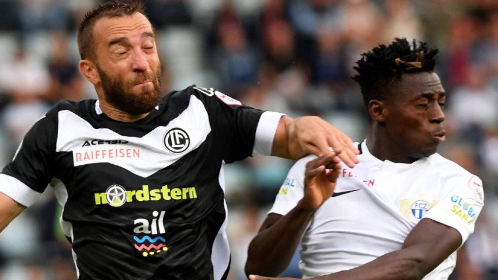 Lugano (Mijat Maric, links) schwingt gegen den FC Zürich (Stephen Odey) obenaus