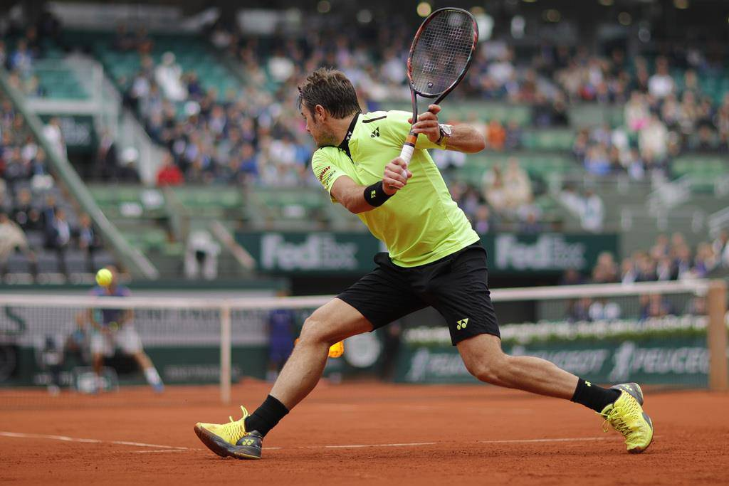 An den French Open 2016 spielte «Stan the Man» in Neongelb (© AP/Christophe Ena)