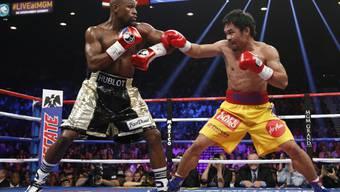 """Floyd Maywather (links) und Manny Pacquiao führen dank dieses Kampfes die """"Forbes-""""Geldrangliste an"""