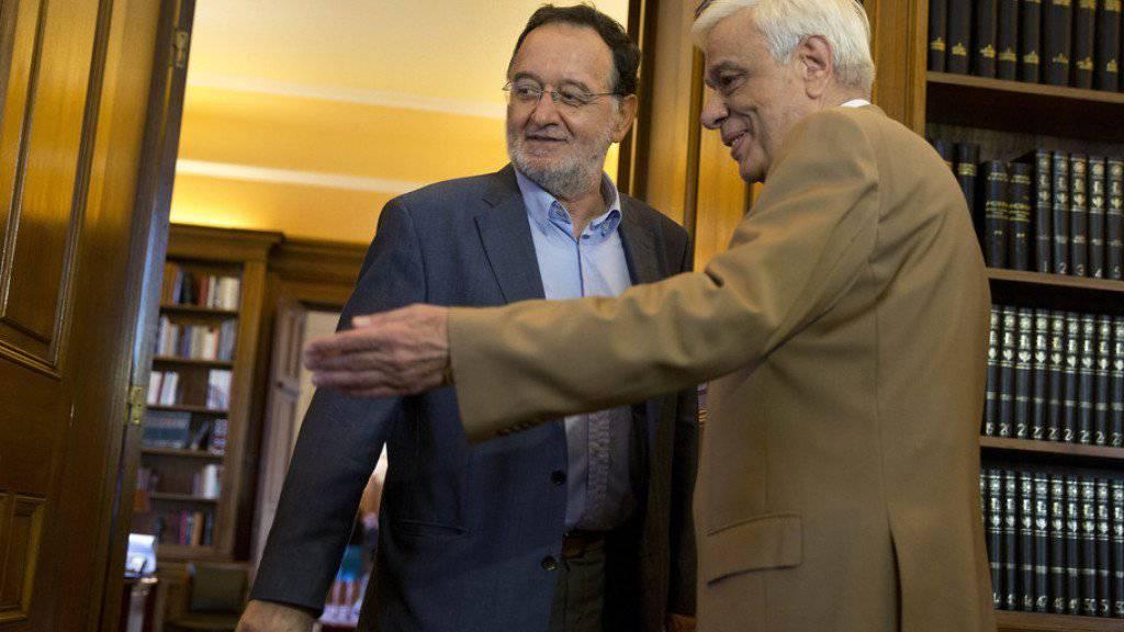 Panagiotis Lafazanis (links) wurde am Montag in Athen von Präsident Prokopis Pavlopoulos offiziell mit der Regierungsbildung beauftragt.