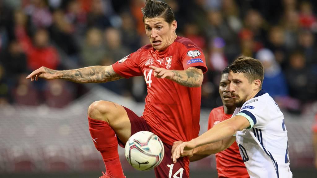 Zuber schiesst das erste Goal der Schweizer.
