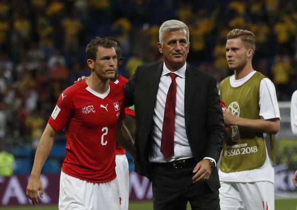 Switzerland head coach Vladimir Petkovic, right, and Switzerland's Stephan Lichtsteiner, left, at the end of the match during the group E match between Brazil and Switzerland at the 2018 soccer World Cup in the Rostov Arena in Rostov-on-Don, Russia, Sunday, June 17, 2018. (AP Photo/Darko Vojinovic)