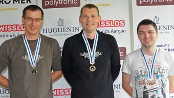 Die Medaillengewinner im A-Match auf die 50-m-Distanz: (von links) Remo Bugmann (2.), Dieter Grossen (Aargauer Meister) und Thomas Vock (3.).