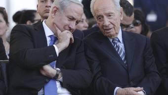 Israels Präsident Peres (r) und Regierungschef Netanjahu