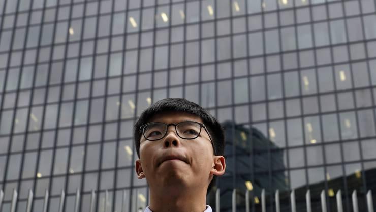 24 und schon am Ende seiner politischen Karriere? Das Regime in Peking will den Hongkonger Demokratie-Aktivisten Joshua Wong ruhigstellen.