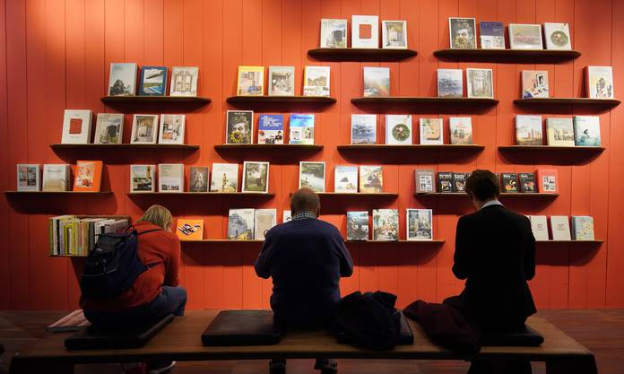 epaselect epa07927171 Visitors look at books at the book fair Frankfurter Buchmesse 2019, in Frankfurt am Main, Germany, 17 October 2019. The 71st edition of the international Frankfurt Book Fair, described as the world's most important fair for the print and digital content business, runs from 16 to 20 October and gathers authors, writers and celebrities from all over the world. This year's Guest of Honour country is Norway. EPA/RONALD WITTEK