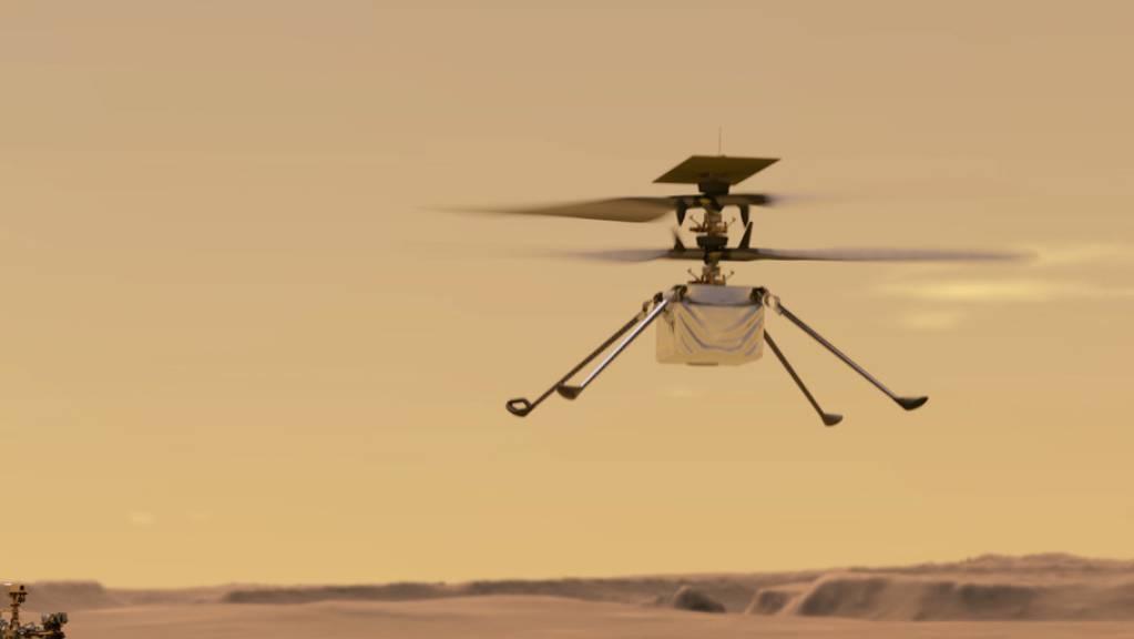 Noch ist es bloss eine Illustration, die den Mars-Helikopter über dem Roten Planeten schwebend zeigt. Doch wenn alles gut geht, absolviert er nächsten Sonntag seinen Jungfernflug. (Archivbild)