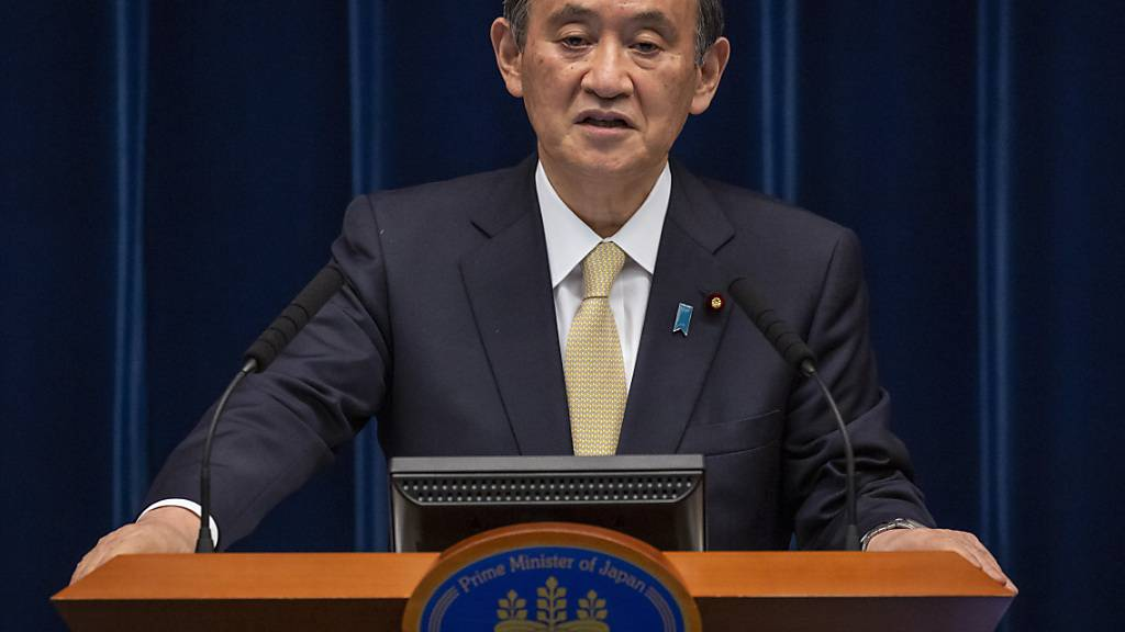 Yoshihide Suga, Premierminister von Japan, spricht während einer Pressekonferenz. Foto: Yuichi Yamazaki/Getty Images pool/AP/dpa