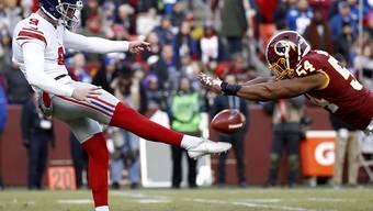 """""""Wer hier gewinnt, ist in Wirklichkeit der Verlierer"""", hiess es in der Vorschau. Die New York Giants (li. Punter Riley Dixon) siegten am Sonntag gegen die Washington Redskins (re. Linebacker Nate Orchard)"""