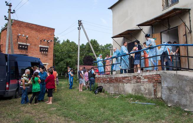 Identifikation von Flutopfern in Kiew.