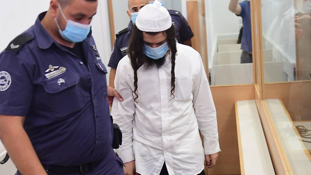 Das Bezirksgericht in Lod bei Tel Aviv verurteilte den 25-jährigen Amiram Ben-Uliel wegen Mordes in drei Fällen. Foto: Avshalom Sassoni/Maariv POOL/AP/dpa