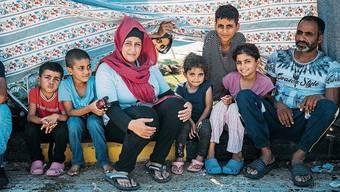 Wafaa, 35, ist mir ihren sechs Kindern und ihrem Mann nur knapp dem Feuer entkommen.