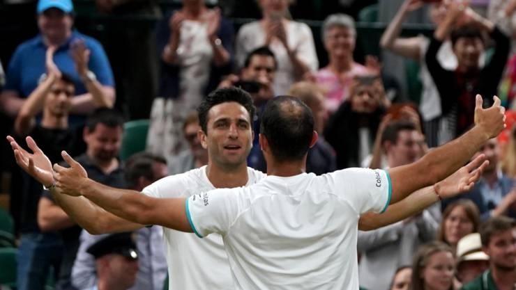 Die Erlösung nach einem epischen Final: Juan Sebastian Cabal (re.) und Robert Farah jubeln in Wimbledon über ihren ersten Grand-Slam-Titel