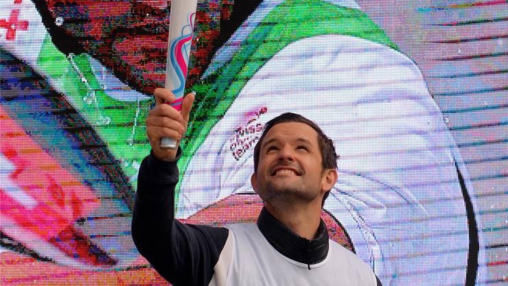 Kanute Mike Kurth als Fackelträger der olympischen Jugendwinterspiele im Januar in Lausanne.