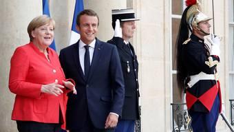Suchen gemeinsame Antworten auf die Flüchtlingskrise: Merkel und Macron.