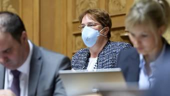 SVP-Nationalrätin Magdalena Martullo-Blocher - im Bild mit Schutzmaske im Parlament. (Archivbild)