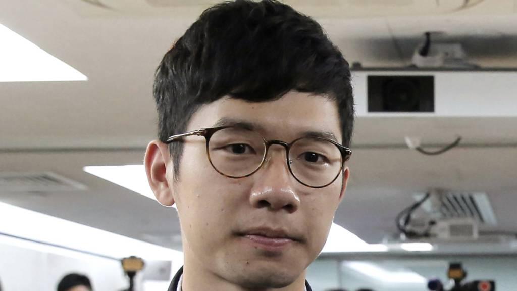 ARCHIV - Der pro-demokratische Aktivist Nathan Law nimmt an einer Pressekonferenz teil. Foto: Kin Cheung/AP/dpa