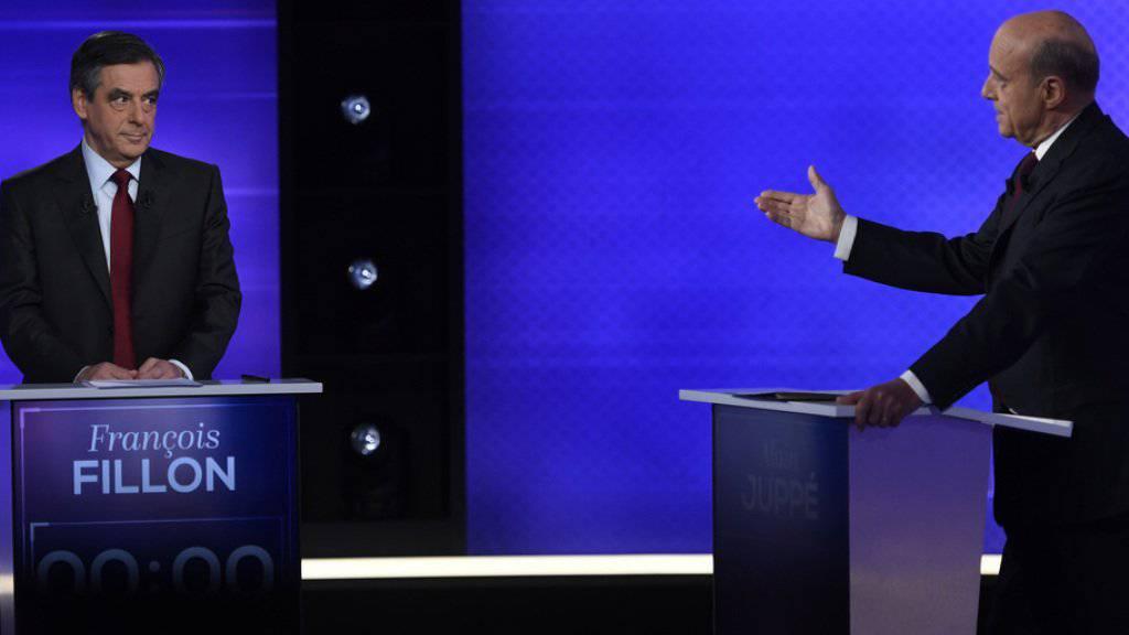 François Fillon (l.) und Alain Juppé beim TV-Duell am Donnerstagabend.