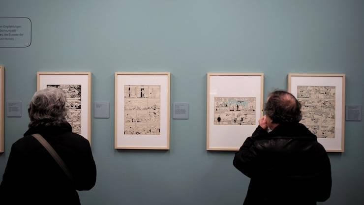 """Im Cartoonmuseum Basel gibt es die """"100 000 Höllenhunde"""", Ligne claire, den legendäre Stil von Hergé, andere Zeichnungen und ein Workshop zu erleben."""