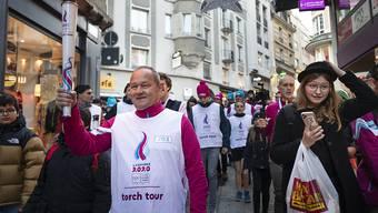 Immer für den Sport im Einsatz: Swiss-Olympic-Präsident Jürg Stahl beim Fackellauf vor den Olympischen Jugendspielen im Januar in Lausanne