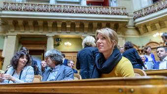 Drei der über 70 neuen Parlamentarier in Bern: Anna Giacometti (FDP/GR), Bruno Storni (SP/TI) und Greta Gysin (Grüne/TI) im Nationalratssaal (v.l.n.r).