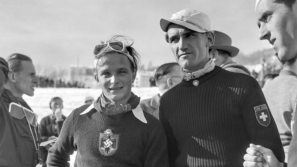 Rudolf Rominger (rechts) mit Josef Jennewein, der als Fahrer des Deutschen Reichs die Abfahrt und die Kombination gewann