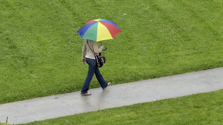 Frau mit Regenschirm.