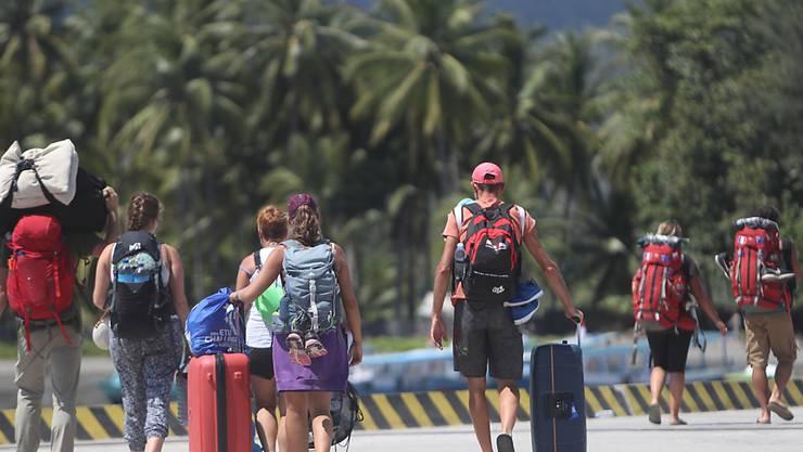 Abreise: Viele Touristen wollen nach den Erdbeben die indonesische Ferieninsel Lombok verlassen.