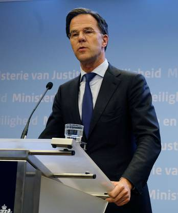 "Dutch Prime Minister Mark Rutte, left, and Justice and Security Minister Ferd Grapperhaus speak to the media at a press conference in The Hague, Netherlands, Monday, March 18, 2019. Dutch police are hunting down a suspect after a shooting on a tram in the central Dutch city of Utrecht that left several dead and more wounded. Authorities immediately raised the terror alert for the area to the maximum level. ""Our nation was hit by an attack in Utrecht,"" Dutch Prime Minister Mark Rutte said. He said that ""a terror motive is not excluded."" (AP Photo/Michael Corder)"