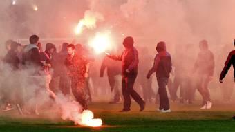 Rayonverbote und Meldeauflagen sind im Konkordat über Massnahmen gegen Gewalt anlässlich von Sportveranstaltungen (Hooligankonkordat) geregelt. (Archiv)