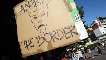 """Die Demonstration in der italienischen Grenzstadt Como hat ein Nachspiel für elf Aktivisten der Gruppe """"no borders"""". Sie werden mit einem Rayonverbot belegt. (Archivbild)"""