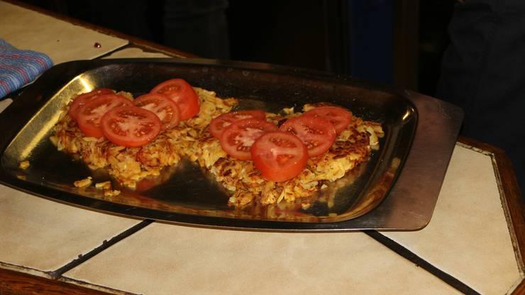 Mit saftigen Tomaten ist die starke Verbundenheit zum Wallis dargestellt.