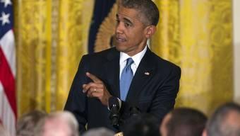 Wenn man bei Barack Obama zu Hause ist, hat man sich gefälligst zu benehmen - das machte der US-Präsident einem Zwischenrufer klar.