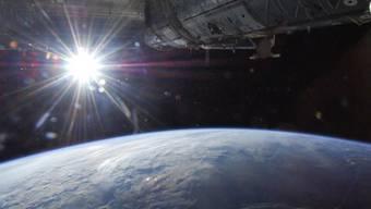 Ein etwas anderer Sonnenaufgang - von der ISS aus aufgenommen
