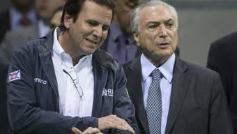 Müssen grosse Herausforderungen meistern: Rios Bürgermeister Eduardo Paes (links) und Brasiliens Interimspräsident Michel Temer