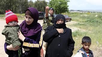 Menschen in Syrien auf der Flucht (Symbolbild)