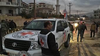 Ein IKRK-Hilfskonvoi erreicht das eingeschlossene Madaja nordwestlich der syrischen Hauptstadt Damaskus (Aufnahme vom Januar 2016).