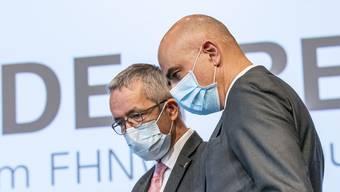 Alain Berset und Thomas Weber an der Medienkonferenz im Muttenz.