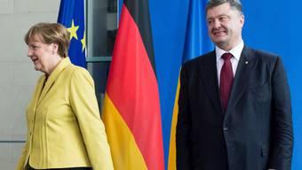 Nicht diese Töne! Merkel dämpfte Poroschenko.