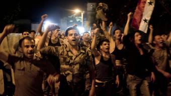 Syrische Soldaten feiern für Assad