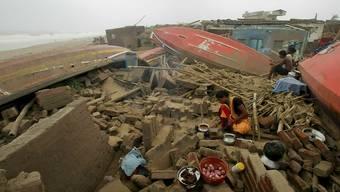 """Der Zyklon """"Fani"""" hat in Indien grosse Schäden angerichtet, wie hier im Fischerdorf Puri."""