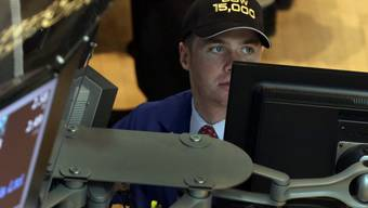 Ein Händler mit Dow-15'000-Mütze an der New Yorker Börse