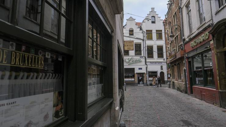 Eine nächtliche Ausgangssperre und weitere Beschränkungen sorgen in Belgien für geschlossene Restaurants und verlassene Innenstädte.