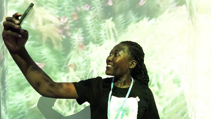 Ein Selfie muss sein: Besuch in der Wald-Ausstellung an der Klimakonferenz in Kattowitz.