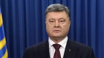 Der ukrainische Präsident Petro Poroschenko hat ein Kriegsrechts-Dekret unterzeichnet. (Archiv)