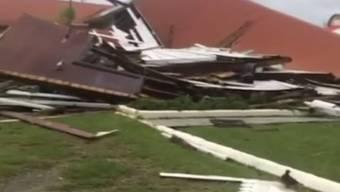 "In der Hauptstadt des Pazifik-Inselstaats Tonga zerstört Zyklon ""Gita"" das Parlamentsgebäude."