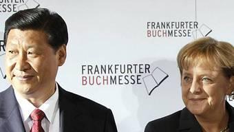 China und Deutschland zeigen sich solidarisch angesichts des US-Klimaexits: Im Bild: Chinas Präsident Xi Jinping und Deutschlands Bundeskanzlerin Angela Merkel. (Archivbild)