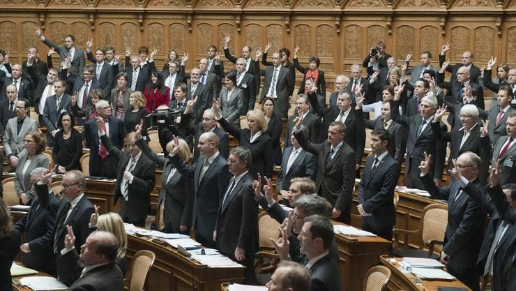 Die neue sogenannte Mitte des Nationalrats mit CVP, BDP und GLP leistet den Eid